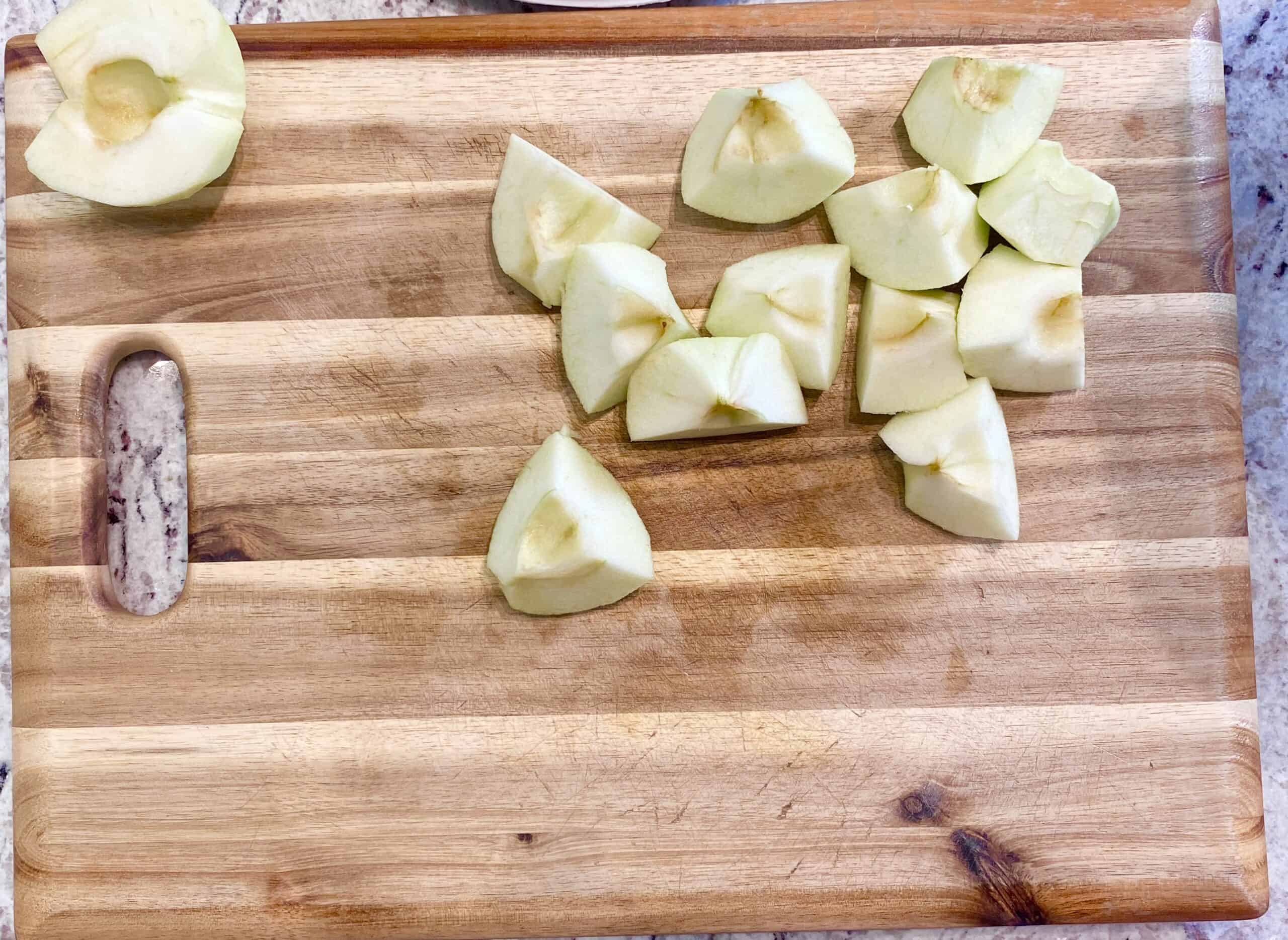 Chopped apples on a wooden cutting board