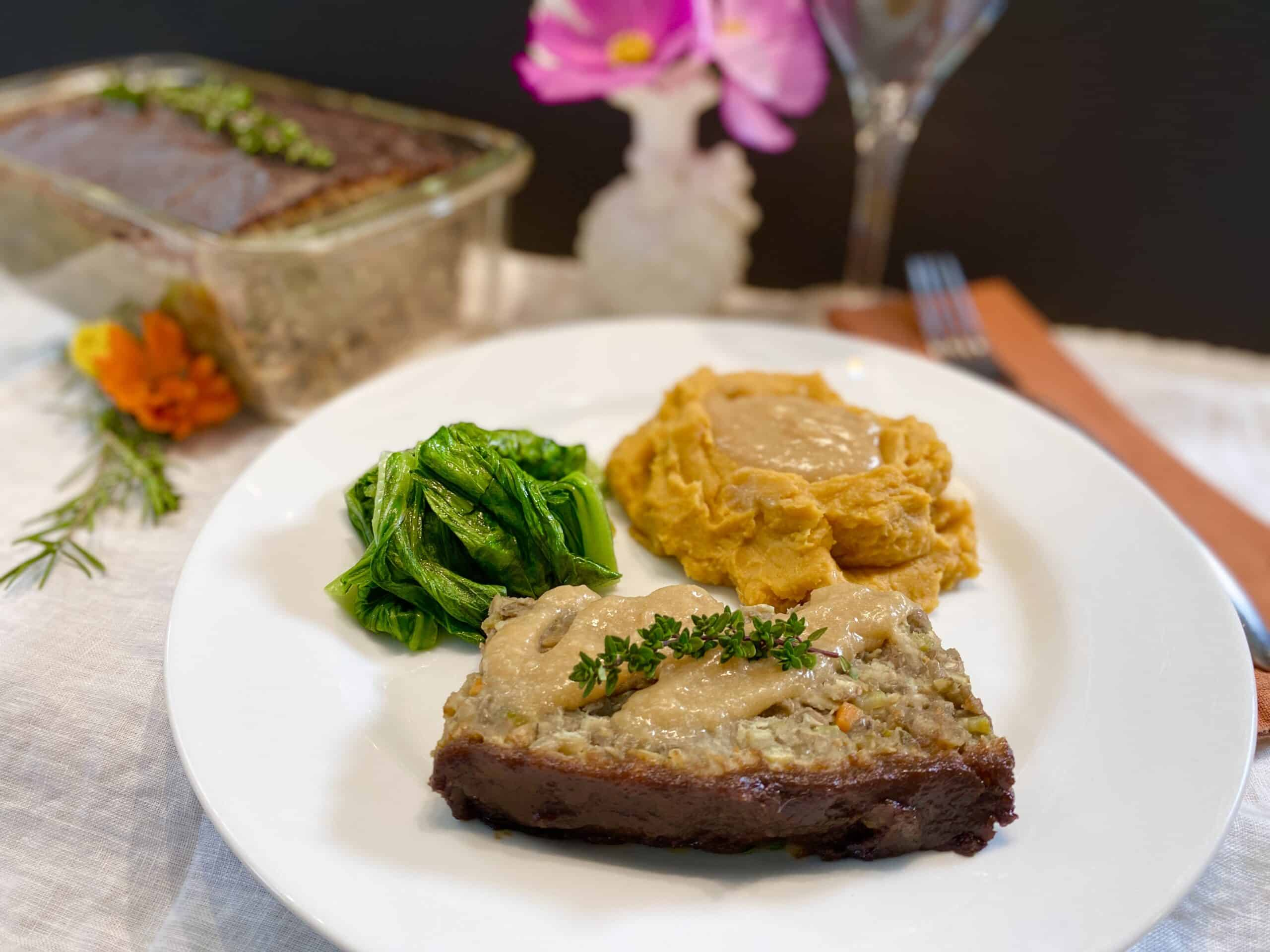 Lentil loaf, mashed sweet potatoes and bok choy on a plate