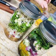 Making two different styles of mason jar salads for plant-based meal prep