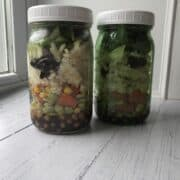 Two large mason jar salads with vegan ingredients for healthy meal prep
