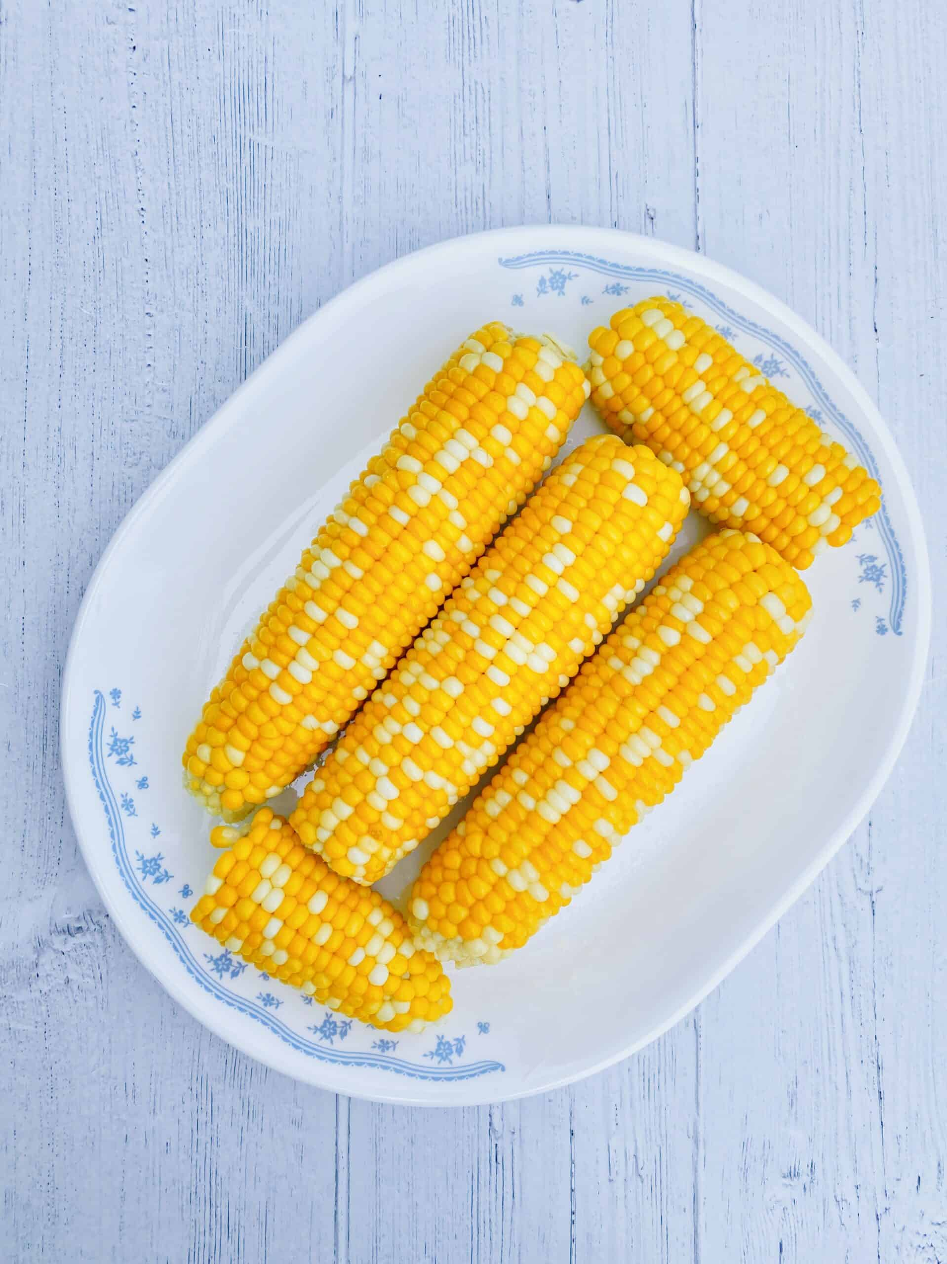 Corn on the cob on a flowered plate