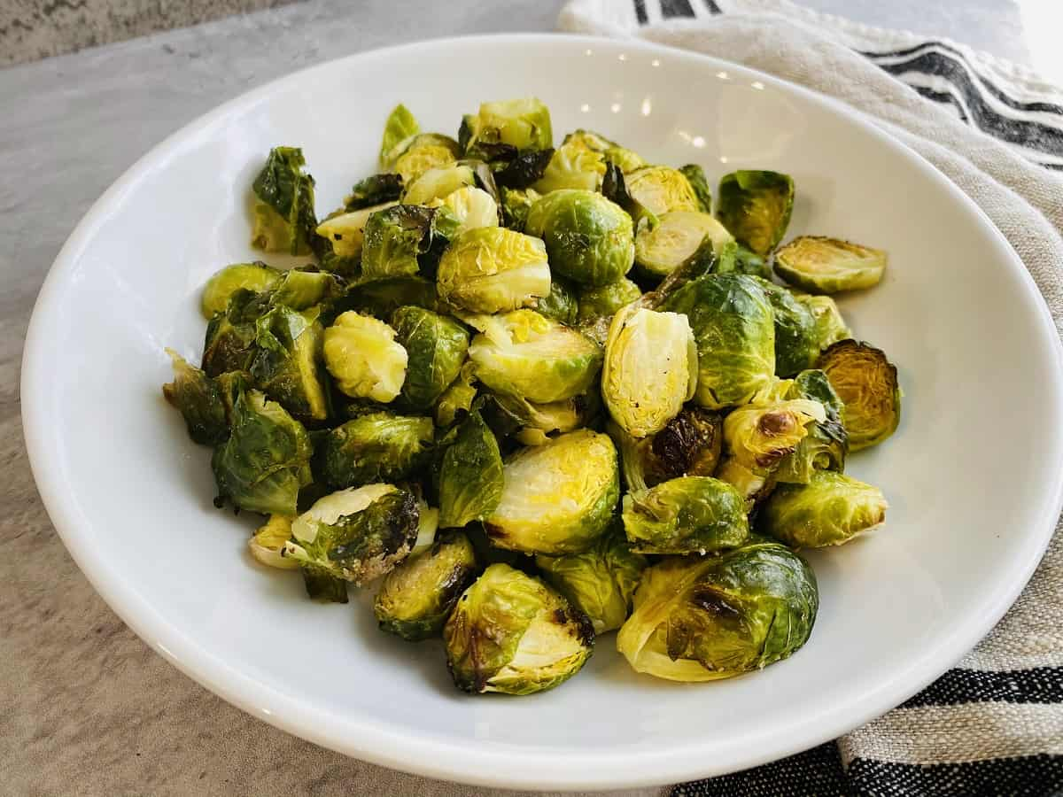 roasted Brussels sprouts in white bowl