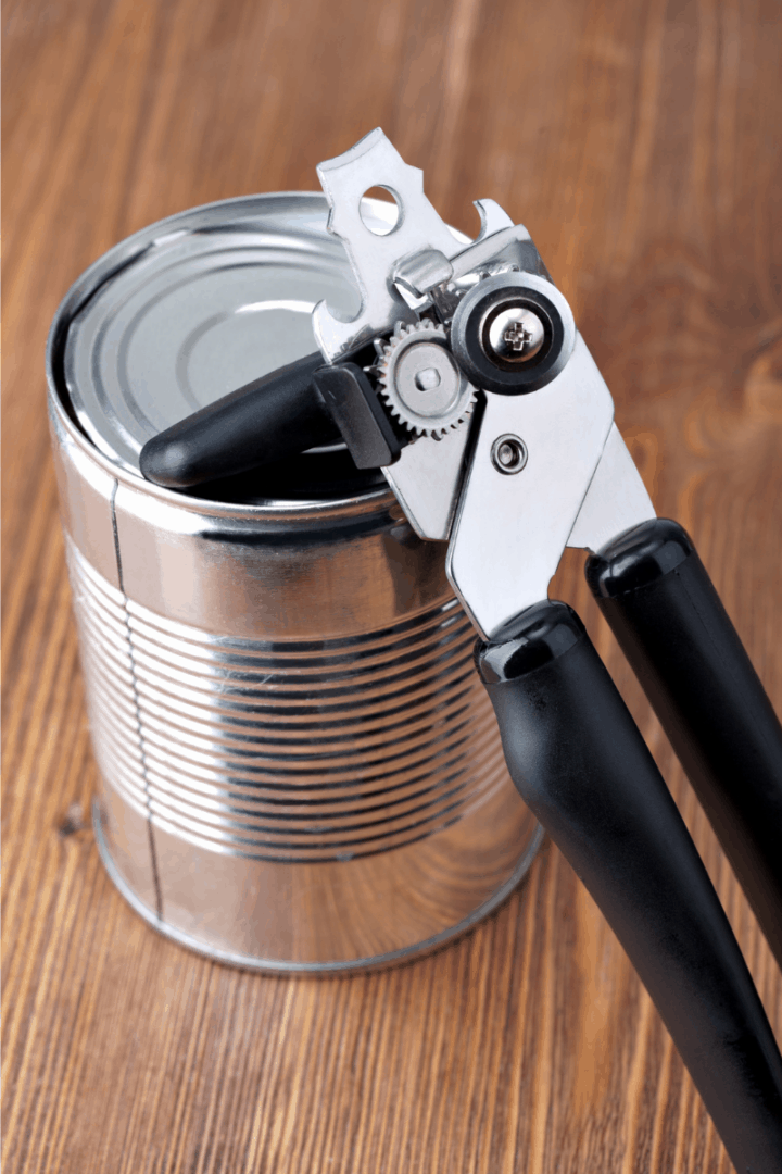 can opener opening a tin
