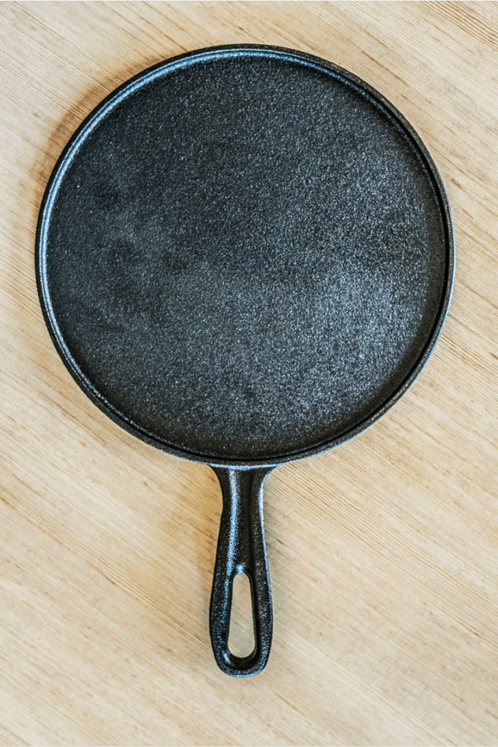 cast iron griddle on a wooden background