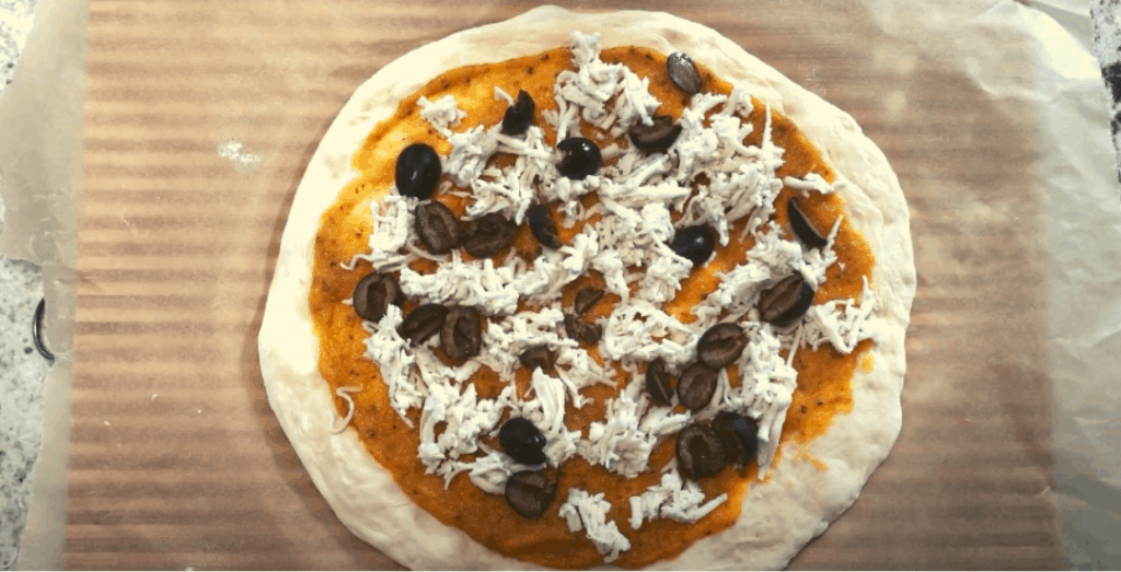 Assembled pizza before entering the oven